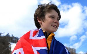 An image of Ben Tudhope carrying the Australian flag