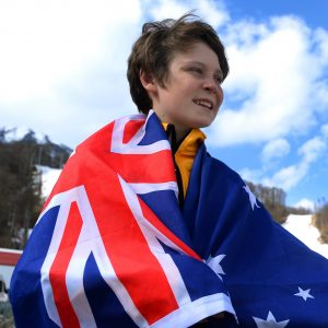 An image of Ben Tudhope carrying the Australian flag