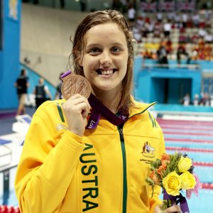 An image of Ellie Cole holding her bronze medal