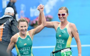 An image of Katie Kelly and Michellie Jones smiling and congratulating each other