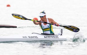 Image of a female athlete in action during para-canoeing