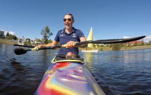 Image of Amanda Reynolds smiling on a canoe