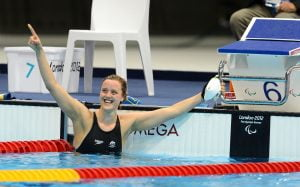 An image of Ellie Cole in the pool, smiling.