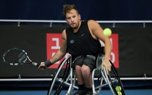 An image of Dylan Alcott in action during wheelchair tennis