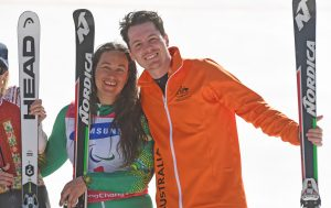 An image of Melissa Perrine and Christian Geiger smiling while holding ski equipment