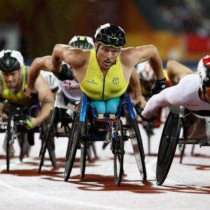 An image of Kurt Fearnley participating in athletics with other parathletes