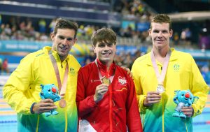 An image of Liam Schluter, Daniel fox and Michael Dodge holding their medals
