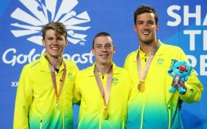 An image of Timothy Hodge, Timothy Disken and Blake Cochrane smiling with their medals