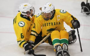 An image of players in a para-ice hockey match