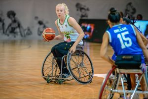 An image of a paraathlete playing wheelchair basketball