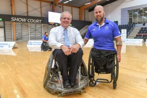 An image of Scott Morrison with a para-athlete. Both are sitting on wheelchairs.