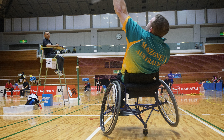 Para-badminton athletes make a racquet