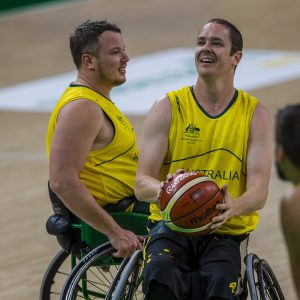 An image of parathletes during a game of wheelchair basketball