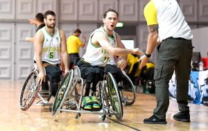 An image of para-athletes during a game of wheelchair basketball
