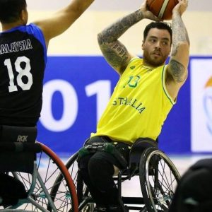 An image of a para-athlete in a match of wheelchair basketball
