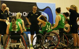 Image of a para-athlete team with coaches