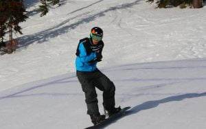 An image of Matt Robinson in action while snow boarding