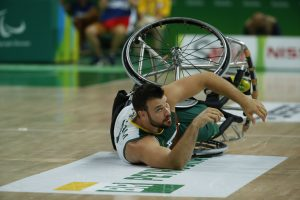 An image of Bill Latham in action during a wheelchair basketball game