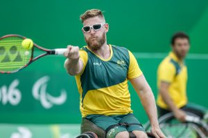 An image of Ben Weekes in action during wheelchair tennis