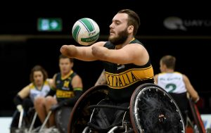 Image of a parathlete playing wheelchair rugby