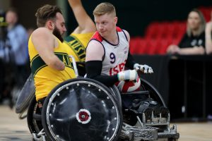 Image of an Australian para-athlete and a para-athlete from a different teamplaying wheelchair basketball