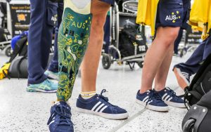 Image of a prosthetic leg in Australian paralympic team colours