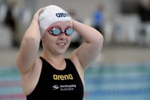 Image of a swimmer smiling in her swimming gear