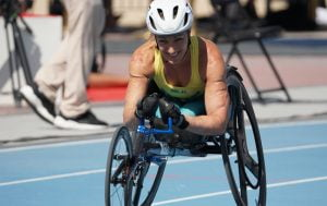 Image of Eliza Ault Connell in action in a wheelchair race