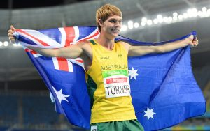 Image of James Turner holding Australian Flag