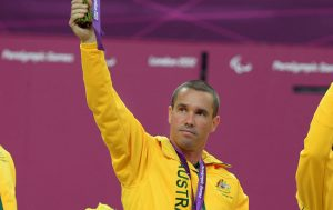 male paralympian hand in the air