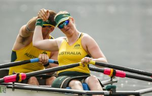 a male and a female australian rowers