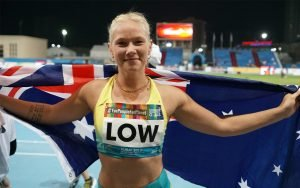 female paralympian smiling with Australian flag