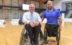 Scott Morrison and Ryley batt smiling in wheelchairs