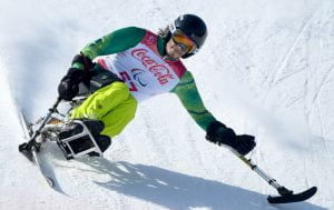 male paralympian sit down skiing