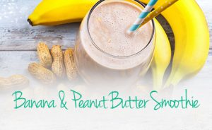 Banana and peanut butter smoothie in a jar with a straw