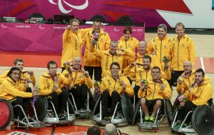 Australian wheelchair rugby team smiling with medal