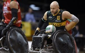 Image of male wheelchair rugby player Chris Bond with the ball