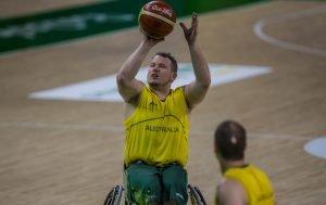 Australian male wheelchair basketball player taking a shot at goal