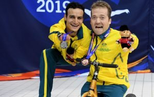 image of two male paralympians with medals