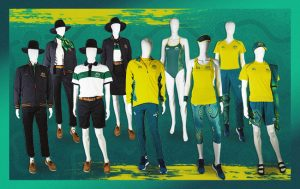 Image featuring a green background and 9 mannequins dressed in a variety of uniforms to be worn by the Australian Paralympic Team at the Tokyo 2020 Paralympic Games.