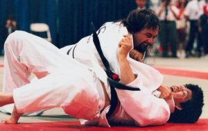 Image of male Paralympian Anthony Clarke in a Judo match with a competitor