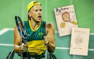 Male wheelchair tennis player, dressed in green and gold, holding a racket in his right hand and pumping his left fist.