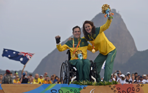Liesl Tesch and Dan Fitzgibbon on the medal podium with a gold medal