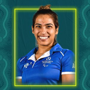 Image containing a dark green background with a yellow border. In the middle is a headshot of Australian para-athlete Madison de Rozario looking straight at the camera. She is wearing a blue t-shirt.