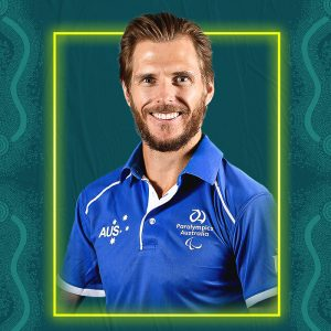 Image containing a dark green background with a yellow border. In the middle is a headshot of Australian para-athlete Michael Roeger looking straight at the camera. He is wearing a blue t-shirt.