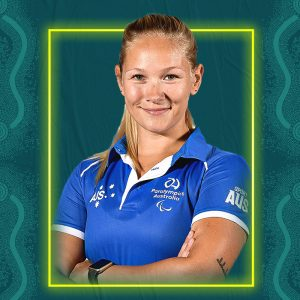 Image containing a dark green background with a yellow border. In the middle is a headshot of Australian para-athlete Vanessa Low looking straight at the camera. She is wearing a blue t-shirt.