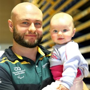 Image of ustralian Steelers Wheelchair Rugby player Chris Bond holding his daughter Victoria.