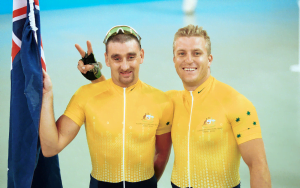 Paul Clohessy and Darren Harry on podium smiling with Australian Flag