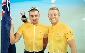 Paul Clohessy and Darren Harry on podium smiling with Australian Flag