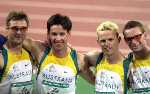 4 male Paralympian athletes: Fuller, Wilson, Matthews, Francis smiling after winning their 4x400m relay race